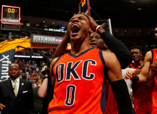 Oklahoma City Thunder guard Russell Westbrook celebrates after hitting a buzzer beater three point shot to win the game against the Denver Nuggets following a basketball game Sunday, April 9, 2017, in Denver. Oklahoma City beat Denver 106-105. Westbrook also broke the NBA record for triple doubles with 42. (AP Photo/Jack Dempsey)