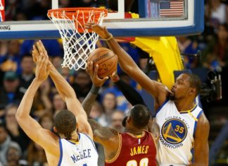 Golden State Warriors Kevin Durant (35) and JaVale McGee (1) double team Cleveland Cavaliers LeBron James (23) in the first quarter of their game at Oracle Arena in Oakland, Calif., on Monday, Jan. 16, 2017. (Jane Tyska/Bay Area News Group)